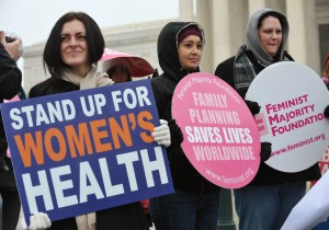 (FILES)Pro-choice activists hold placards during a rally outside of the Supreme Court in this January 23, 2012 file photo in Washington, DC. Women could well swing the outcome of the US presidential election, and both candidates know it, playing up issues like health care and abortion in the countdown to November 6. AFP PHOTO/Mandel NGAN/FILESMANDEL NGAN/AFP/Getty Images