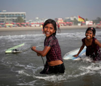 Aisha, 10, Johanara, 10, surf in Cox's Bazar, January, 2015.